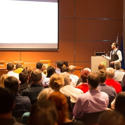 corporate event company Speaker at Business Conference and Presentation.